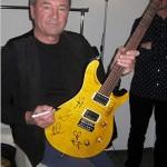 Ian Gillan with signed Fame guitar