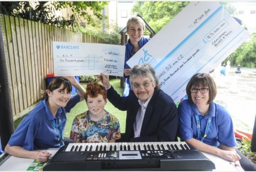 Don Airey with the staff of children's ward at Addenbrooke's Hospital