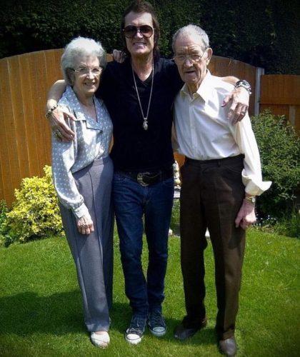 Glenn Hughes and his parents